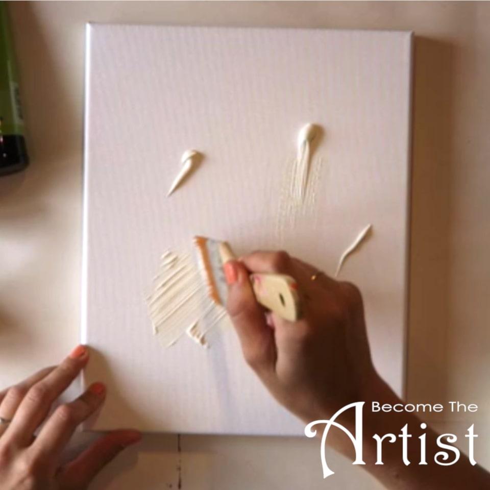 peindre fond blanc sur une toile en peinture acrylique