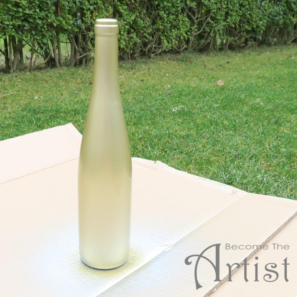 bouteille de vin dorée